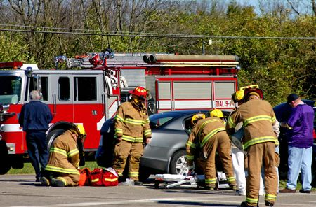 accident at work: Fire fighters at work on the scene of accident Stock Photo