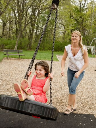 Mom Swinging Daughter
