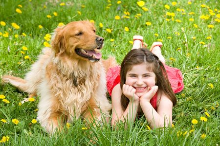 Little Girl Laying Down With Dog photo