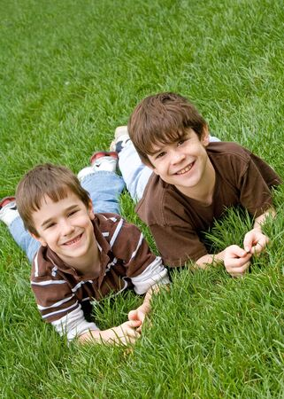 Two Brothers Laying in the Grass Stock Photo - 3048920