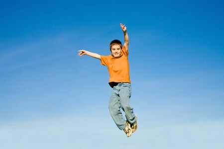 Boy Jumping into the Sky photo