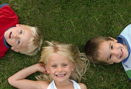 making face: Group of Three Kids Stock Photo
