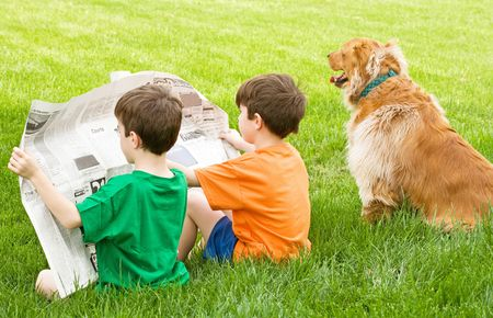 Boys Reading the Newspaper Stock Photo