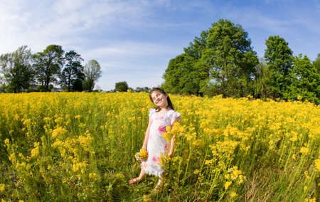 Girl in a Flower Field Stock Photo - 3137165