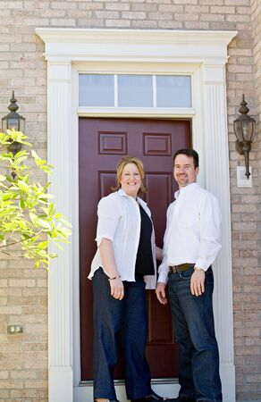 mate married: Couple in Front of Their Home Stock Photo