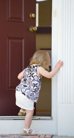 doors open: Little Girl Going into Home