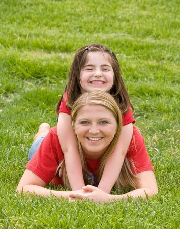Little Girl Playing on Mom's Back Stock Photo - 3226820