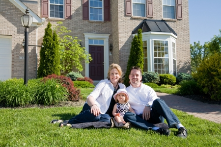 front house: Family in Front of House Stock Photo