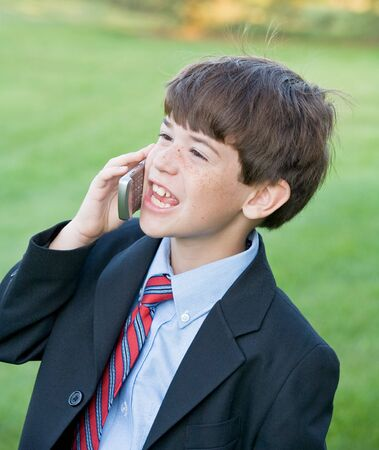Little Business Man Talking on Cell Phone Stock Photo - 3239598