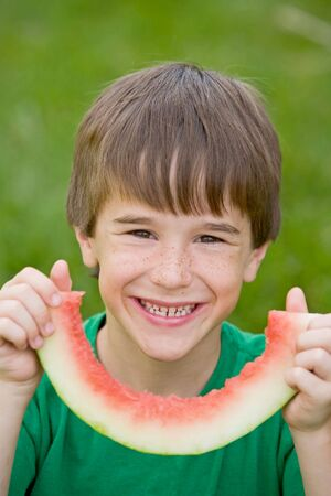 Boy Eating Watermelon Stock Photo - 3239592