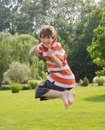 Boy Jumping in the Air Stock Photo