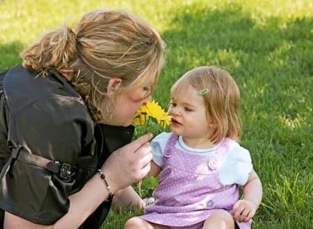Mom and Daughter Smelling a Flower photo
