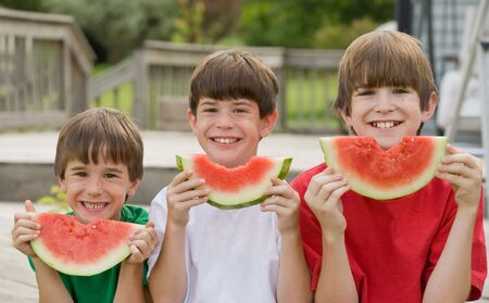 Three Boys Eating Watermelon  photo