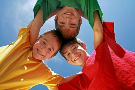 Kids Huddling on a Beautiful Day Stock Photo - 3261502