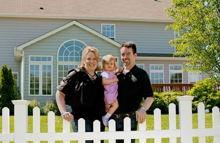 picket fence: Family in Their Backyard of Home