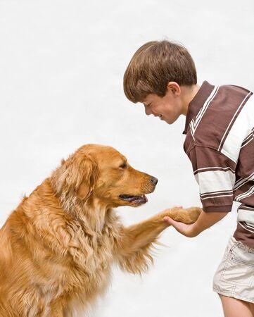 Little Boy Shaking With Dog photo