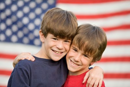 Brothers Hugging in Front of Flag photo