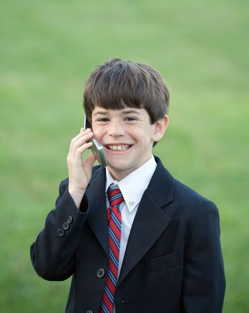 Little Boy Dressed up Talking on Cell Phone photo