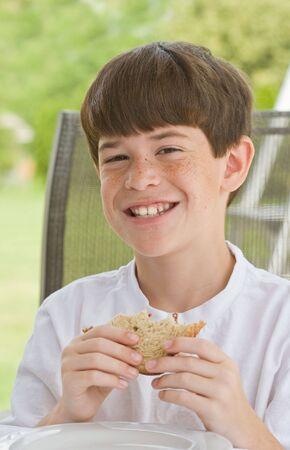 Boy Eating a Sandwich photo