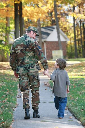 military uniform: Dad and Son Walking Stock Photo