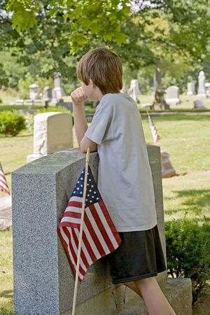 Boy Mourning at Gravesite