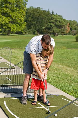 Dad Teaching Son Golf photo