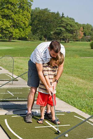 Dad Teaching Son Golf Stock Photo - 3551250