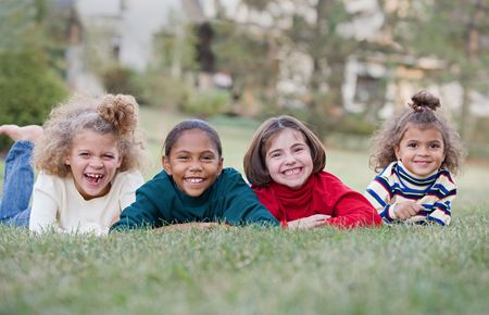 ethnic children: Four Children Laughing in a Row