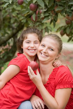 Mother and Daughter in Apple Orchard Stock Photo - 3678903