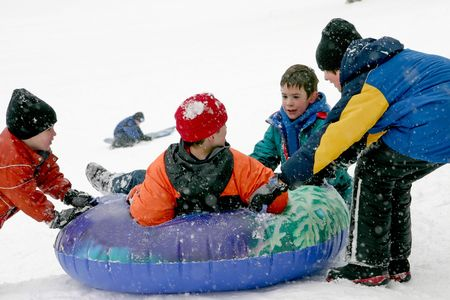 Kids Sledding Stock Photo