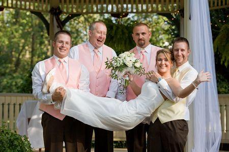 Groomsman Holding the Bride Imagens