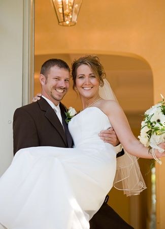 Groom Carrying Bride into Home photo