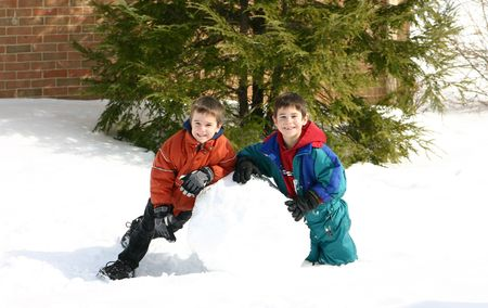 sledding: Boys Playing in the Snow Stock Photo