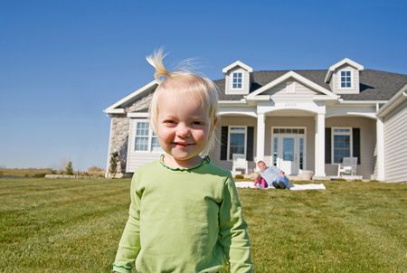front house: Little Girl in Front of Home Stock Photo