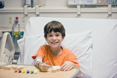 hospital equipment: Little Boy Painting in the Hospital