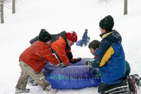 sledding: Kids Sledding Stock Photo
