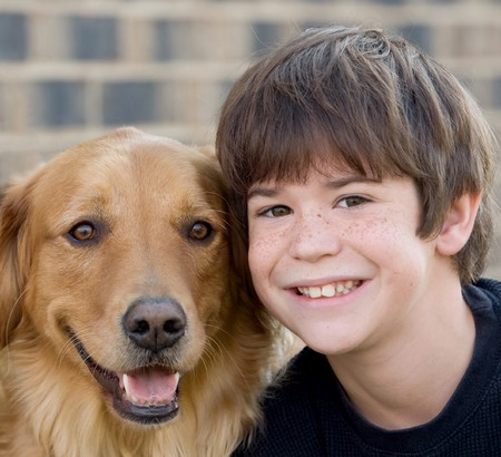 Cute Little Boy Smiling With Dog photo