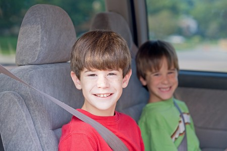 Boys Buckled up in Automobile photo