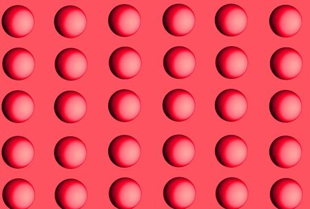 screensaver: Two-tone Pink Balls Arranged in Pattern Against Pink Background Stock Photo