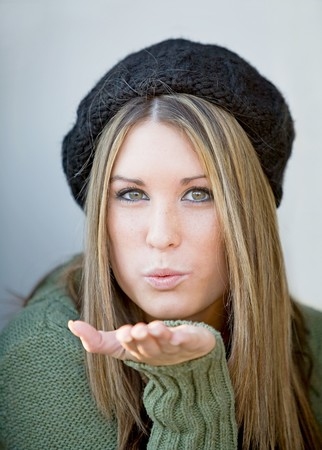 Girl Blowing a Kiss photo