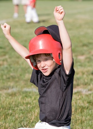 Little Boy Cheering sur le jeu Banque d'images - 4127006