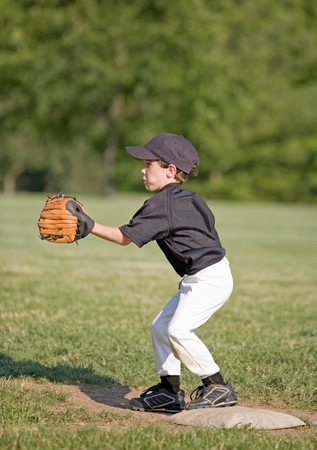 Little Boy Playing First Base Stock Photo - 4126999