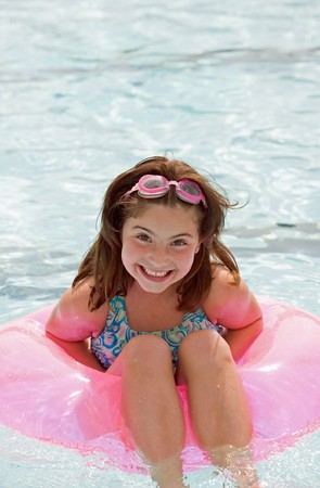 children at play: Little Girl Having Fun Swimming in the Pool