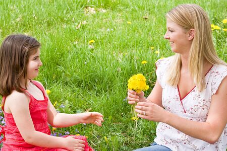 Daughter Giving Mother Flowers photo
