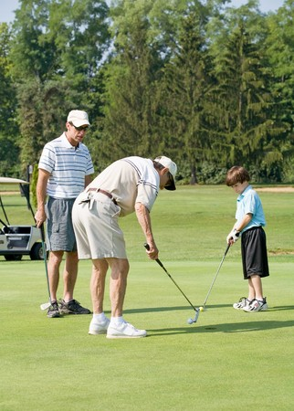 three generations: Family Playing Golf