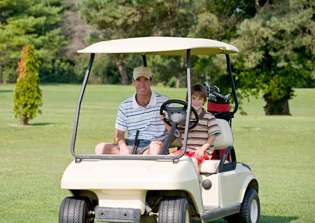 Father and Son in Golf Cart photo