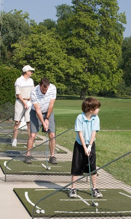 Family Practicing Golf