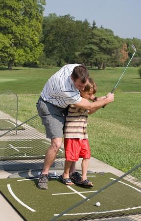 Son papa l'enseignement de Golf Banque d'images - 4294386