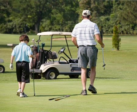 Father and Son Playing Golf photo