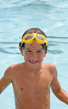 Little Boy Having Fun Swimming in the Pool Stock Photo